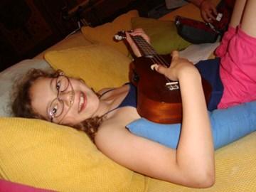 Cayla playing a ukulele