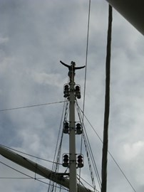 Standing on top of the mast of Tenacious