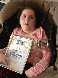 Eve winning a community champion award