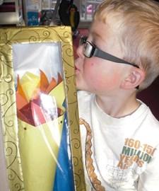 Logan kisses his Olympic Torch