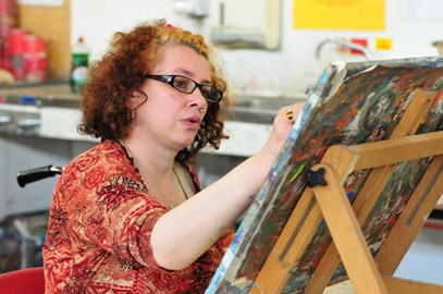 Woman painting at Embrace Arts