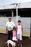 A Masaya family with their solar panel