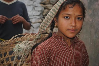Young Nepalese Girl carrying rocks