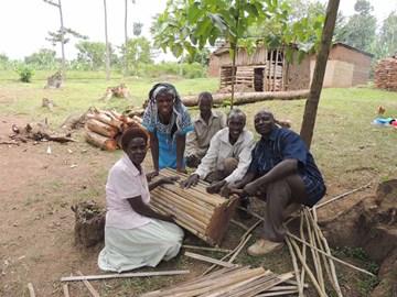 Beekeepers making a hive in Uganda
