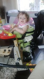 Sophie in her standing frame